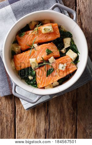 Salmon Fillet Baked With Spinach, Rosemary And Roquefort Cheese Close-up. Vertical Top View