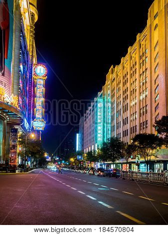 Shanghai, China - Nov 3, 2016: Night scene along Xizang Middle Road - Buildings and neon lights.