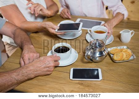 Group of senior friends having coffee in café