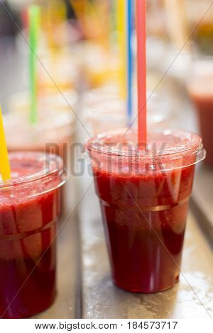 Freshly Squeezed Fruit Cocktail Juices with Colorful Straws