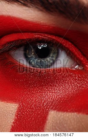 Macro beauty open Eye and red Paint Make-up on Skin