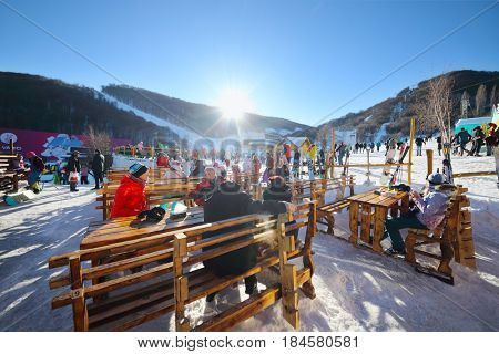 TSAGHKADZOR, ARMENIA - JAN 7, 2017: Resting skiers are in ski resort, Main winter resort of Armenia - Tsakhkadzor is located in picturesque valley near Tegenis mountain