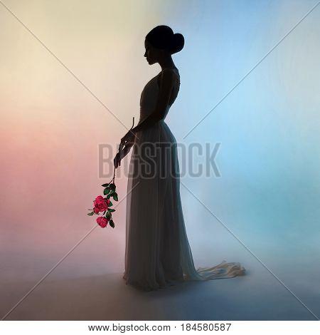 Art fashion studio photo of beautiful elegant woman on colors background. Drawing of shadows and colors. Light and color effects. Fashion style