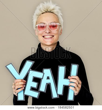 Woman Smiling Happiness Holding Comic Word Yeah Portrait