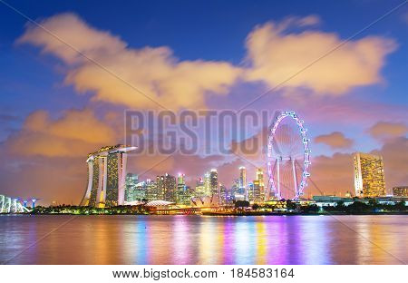 Singapore Downtown Core reflecting in Singapore river at dusk