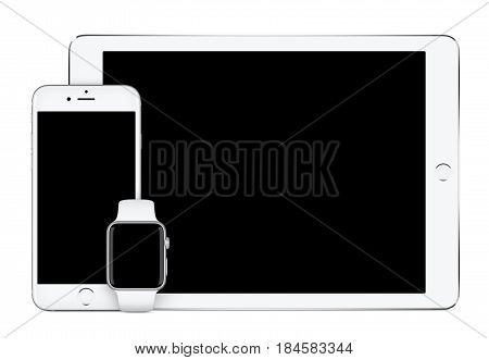 Varna Bulgaria - March 10 2016: Apple Silver iPad Pro Apple iPhone 6S and Apple Watch mockup front view on white background. Technology set for responsive design presentation.