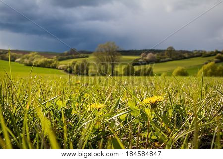 Spring landscape with dark sky and light before rain - Czech Republic Europe