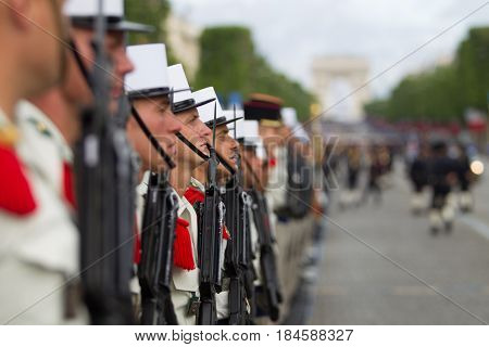 Paris. France. July 14 2012. Rows of foreign legionaries of the French foreign legion against the background of the triumphal arch during the parade on the Champs Elysees in Paris.