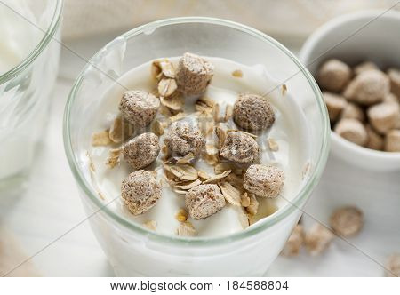 Wheat Bran And Oat Flakes In Glass With Yogurt