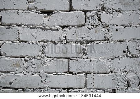 Texture of a white brick wall with rough masonry