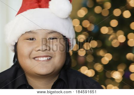 Filipino smiling and wearing santa hat