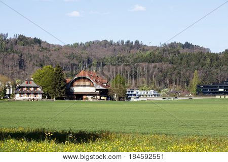 Bern Switzerland - April 13 2017: The variety of buildings between the field and the forest is the landscape that can be seen in the outer districts of the city.