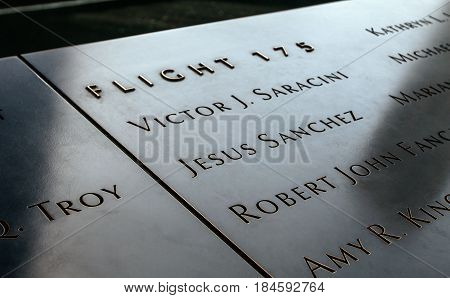 New York April 28 2017: View of a section of names of the victims of the September 11 2001 terrorist attack at 9/11 Memorial in New York City.