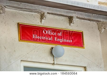 Office of electrical engineer sign at Udaipur, India.