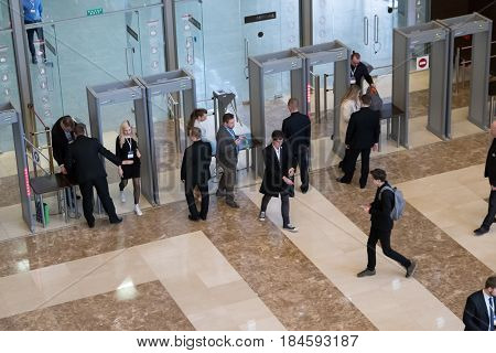 Moscow, Russia - April 24, 2017: Visitors passing security check at Synergy Global Forum at Crocus Expo Hall. This is one of the largest business forums with more than 5000 participants