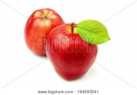 Two red apple Richard with leaf isolated on white background.