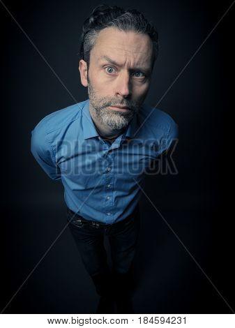 Crazy business man on a dark background
