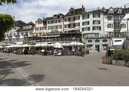 Rapperswil Switzerland - May 10 2016: Outdoor seating restaurant that operates on the ground floor and the first floor by the historic buildings lots of people out there