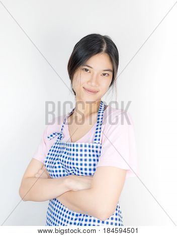 Asian house wife wearing blue kitchen apron isolated on white