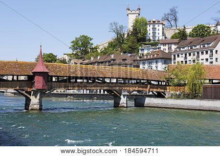 Lucerne Switzerland - May 08 2016: The one of two extant wooden footbridges in the city. Spreuer bridge (Spreuerbrucke) with the buildings behind it creates a picturesque landscape of the city