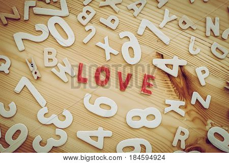 love in red letters surrounded by numbers