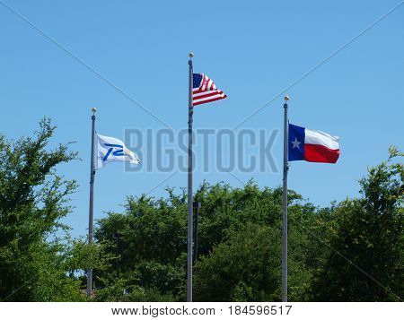 The Richardson City Flag along with the US Flag and the Texas State Flag.