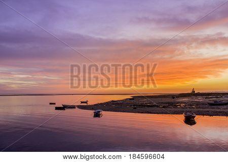 Ria Formosa wetlands natural conservation region landscape sunset view from Olhao port. Algarve Portugal.