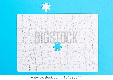 Missing jigsaw puzzle piece . Close up of the last jigsaw puzzle piece. Business concept for completing the final puzzle piece.