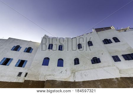 Typical building whit Moroccan windows against a deep blue sky Azemmour El Jadida Morocco
