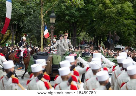 Paris France - July 14 2012. The Chief of Staff of the Armed Forces of the French Republic welcomes the legionaries of the French foreign legion during the parade on the Champs Elysees.