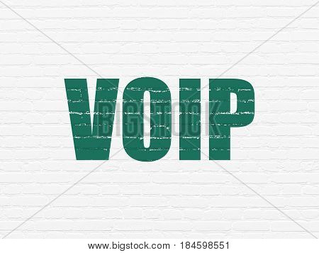 Web development concept: Painted green text VOIP on White Brick wall background
