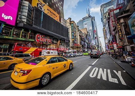 NEW YORK, USA - MAY 25, 2016: Taxis and traffic on a busy 42nd Street in New York City