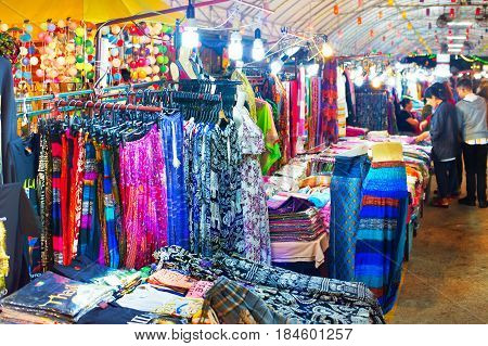 Woman dresses and t-shorts and pants for sell at night market. Chiang Mai Thailand