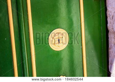 Close up at lock of old green safe India at Udaipur, India.