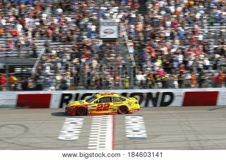 April 30, 2017 - Richmond, Virginia, USA: Joey Logano (22) crosses the finish line to win the Toyota Owners 400 at Richmond International Speedway in Richmond, Virginia.
