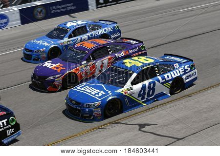 April 30, 2017 - Richmond, Virginia, USA: Jimmie Johnson (48), Denny Hamlin (11) and Kyle Larson (42) battle for position during the Toyota Owners 400 in Richmond, Virginia.