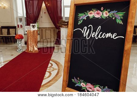 Wedding Welcome Board With Space For Text. Rustic Wooden Wall With Flowers, Photo Booth, Decorated B