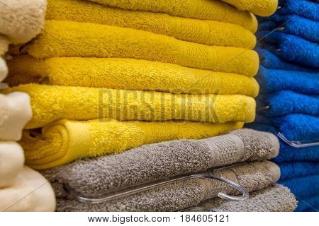 Closeup of colorful towels lying on shelf in store