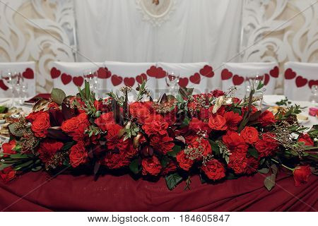 Stylish Centerpiece Table For Bride And Groom With Red Roses, Luxury Decorated Place For Wedding Cer
