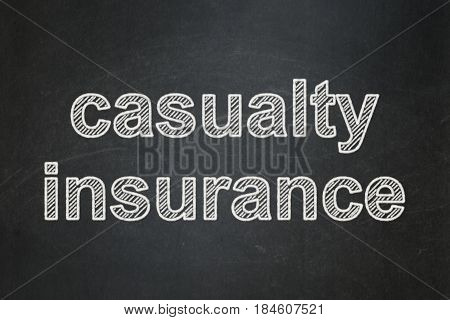 Insurance concept: text Casualty Insurance on Black chalkboard background