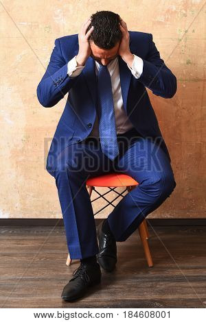 Tired Fashion Business Man Sitting On Chair