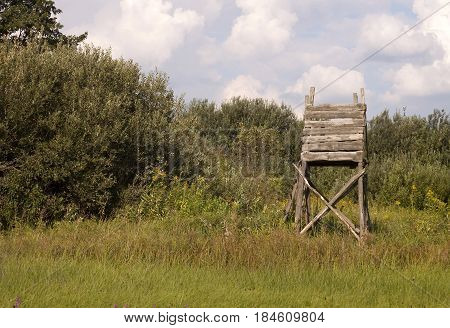 Hunting tower in the field for deer and boar game