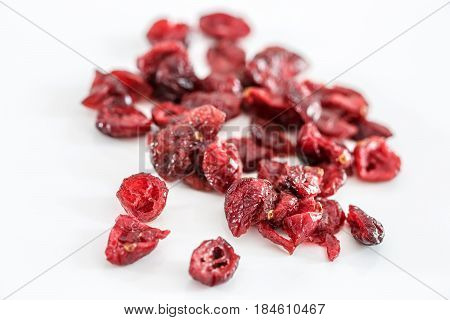 Closeup on dried cranberries isolated on white background