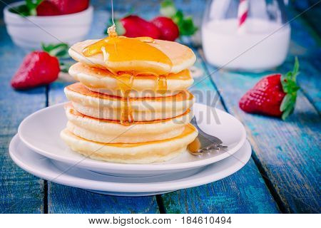 Homemade Pancakes With Honey And Strawberries