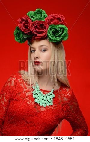 fashion woman in red dress and flower head wreath