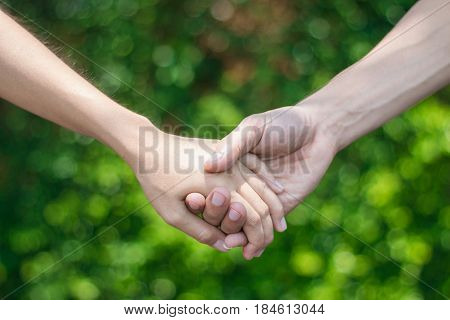Young people hold hands to express their love affair.