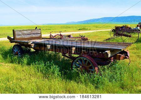 Vintage wooden farming equipment taken on a rural forgotten prairie landscape taken in the Carrizo Plain, CA