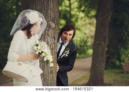 Funny Groom Hides Behind A Tree To Cath A Bride