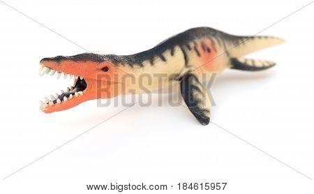 a Liopleurodon toy on a white background