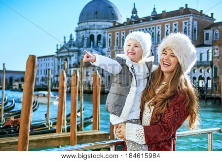 Mother And Daughter Tourists In Venice Looking Into Distance